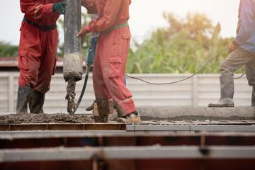 Construction men worker boom concrete on floor