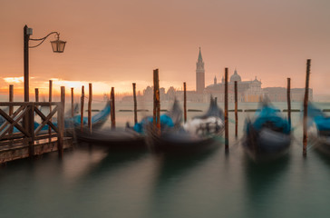 Wall Murals Gondolas Morning in Venice. Gondolas at the pier. Italy.