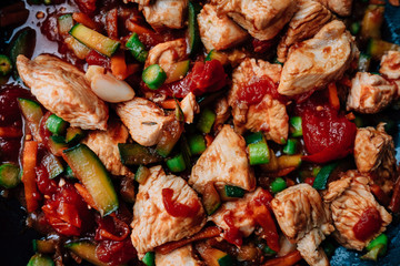 Pork Goulash with a lot of vegetables like tomatoes, asparagus, Capsicum annuum , Zucchini and onion.