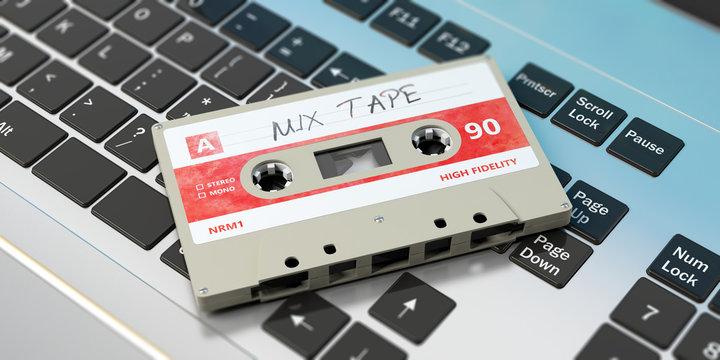 Vintage audio cassette, text mix tape on the label, on a laptop. 3d illustration