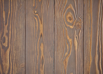 The texture of the wood is brown, the vertical arrangement of the boards. Wooden background.