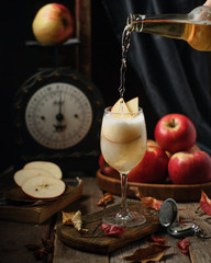 Homemade apple cider, fresh organic red apples, vintage scales on a wooden rustic old background. Close up. Selective focus