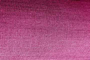 Jeans cloth pattern in pink color.