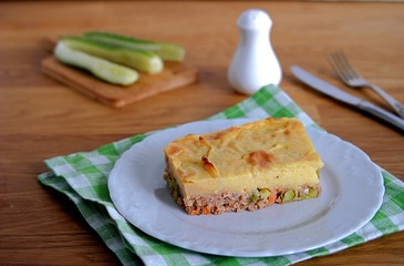 Portion of shepherd's pie, a traditional British casserole with mashed potatoes, meat and vegetables.