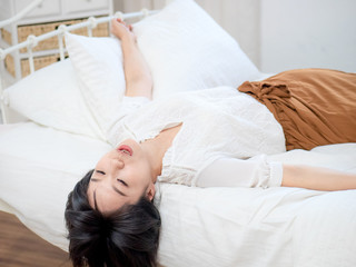 young lady tender girl lying in bed relaxing