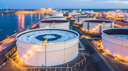 Aerial view oil terminal is industrial facility for storage of oil and petrochemical products ready for transport to further storage facilities. Wall mural