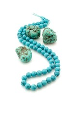 Turquoise gemstones with beads necklace on white