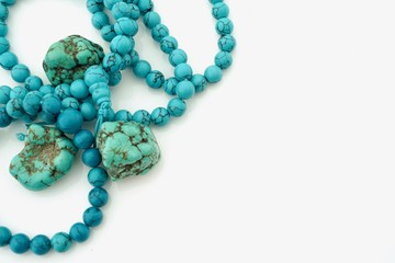 Turqoise gemstones and necklaces with copy space