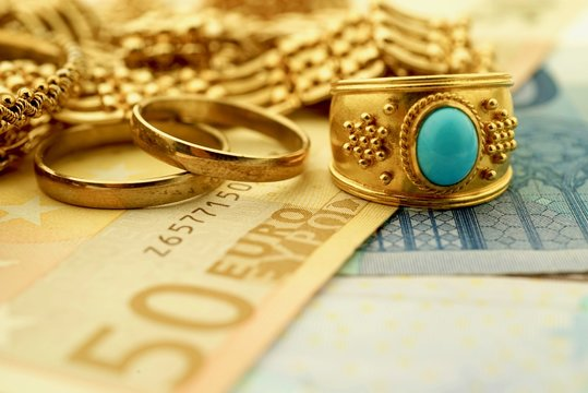 Vintage gold jewelry and euro notes