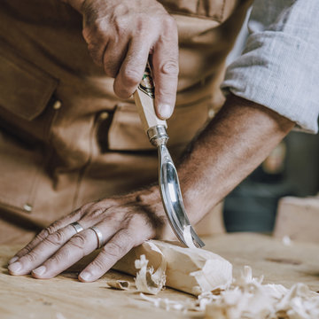 carpenter's hands use chiesel