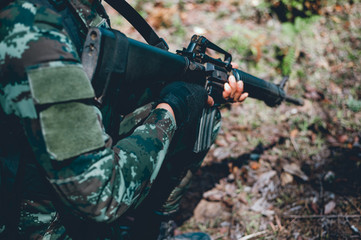 Soldiers are using the radio. And use the map For communication between military operations in the border forest. Guardian