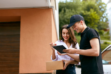 Delivery Courier. Man Delivering Package To Woman