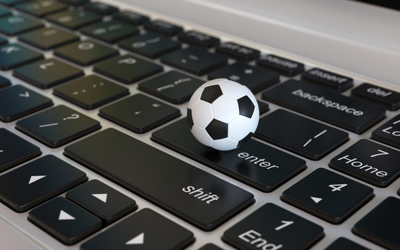 Football ball, soccer ball, on laptop keyboard, 3d rendering