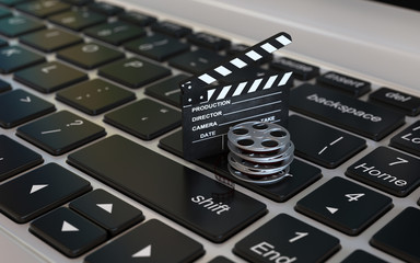 Laptop with films reel and movie clapper, Video editing or online movie internet concept 3d rendering