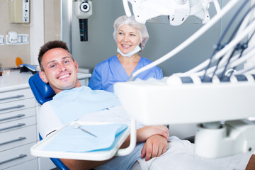 Man in dental chair waiting for examination