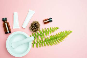 natural cosmetics skincare and leaves on pink