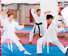 Kids in kimonos practicing effective karate techniques