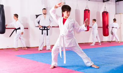 Boy training karate movements in gym