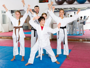 Happy kids karate group with coach