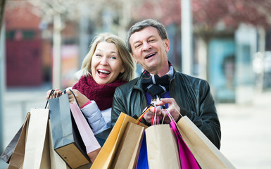 Couple with shopping bags outdoors