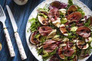 Salad with figs salami avocado mozzarella and arugula