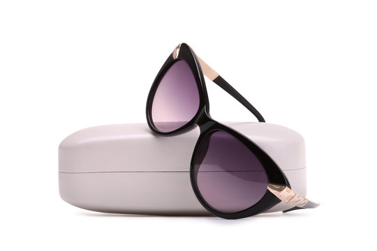 Sunglasses in a storage case on a white background
