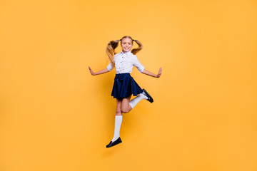 Summer holidays smart small people person concept. Full length body size studio photo portrait of nice glad cheerful excited schoolchild jumping up isolated bright pastel color background