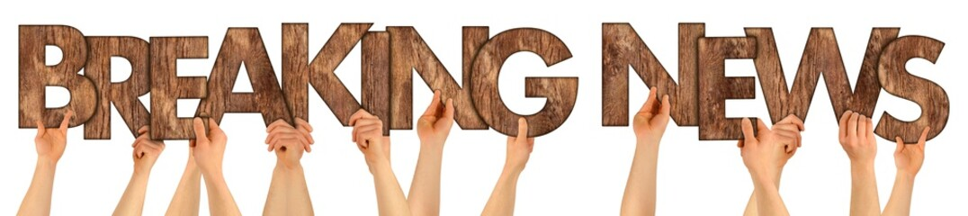 BREAKING NEWS people holding up wooden wood oak rustic wooden letters isolated on white background message newsletter information business concept