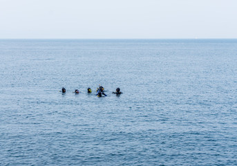 Scuba Divers On The Surface