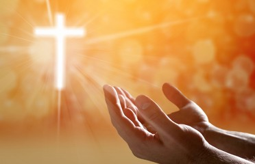 Hands of human praying on blurred background