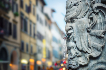 Fountain with drinking water on a street in Florence, Italy