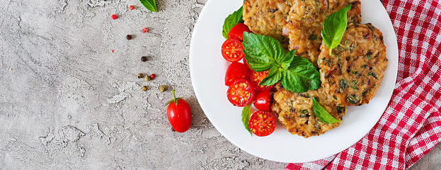 Spicy vegan burgers with rice, chickpeas and herbs. Salad tomato and basil. Vegetarian food. Top view. Banner. Flat lay