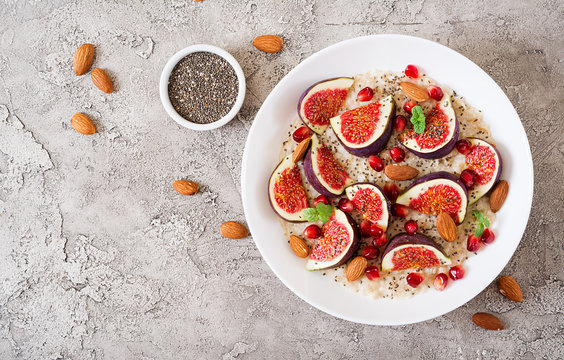 Delicious and healthy oatmeal with figs, almond and chia seeds. Healthy breakfast. Fitness food. Proper nutrition. Flat lay. Top view.