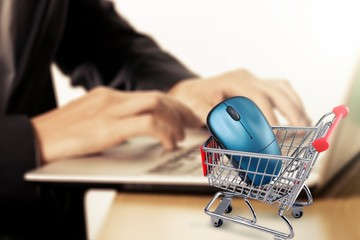 Shopping Cart with computer mouse and laptop