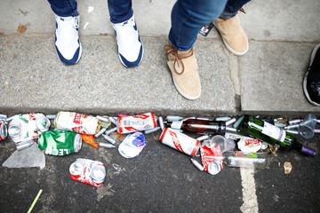 Empty canisters and beer cans can be seen on the ground during the Notting Hill Carnival in London