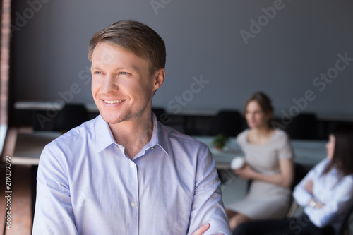 Smiling handsome businessman look in distance dreaming of future