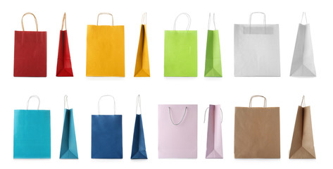 Set with shopping bags on white background