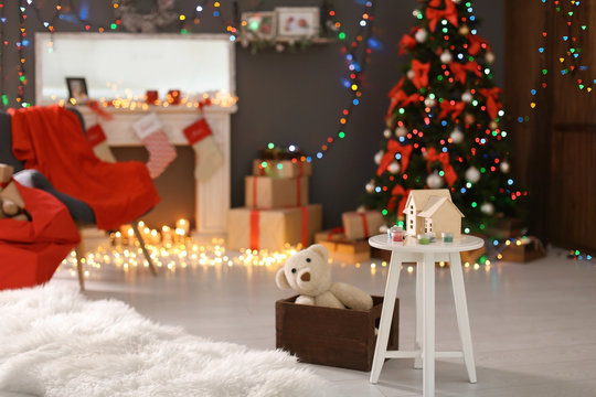 Santa's room interior with toys and Christmas tree