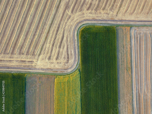 Wall mural Panoramic view from flying drones to agricultural fields, prepared for sowing crops. Top view.