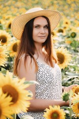 girl in hat, walking on the field of sunflowers, smiling beautiful smile, cheerful girl, style, lifestyle.