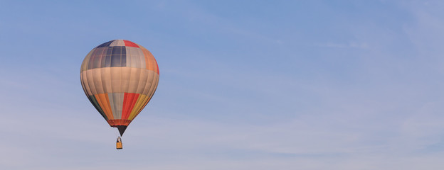Colorful hot-air balloon flying in the sky