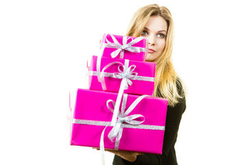 Confused woman holding gifts