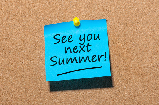 See you next Summer written on a note pinned at the office corkboard
