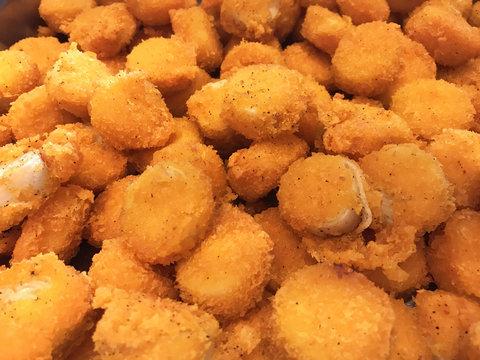 Asian Buffet Food menu: Delicious Deep Fried Scallop with Tartar Sauce. Thai seafood restaurant banquet dish concept.