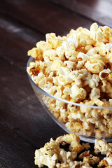 Cinema concept with popcorn on rustic table