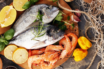 Delicious fresh fish. Fish with aromatic herbs, spices and vegetables - healthy food, diet or cooking concept.