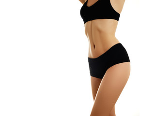 Perfect slim toned young body of the girl. Sports, fitness or plastic surgery and aesthetic cosmetology. Beauty body. Body care. Clean skin