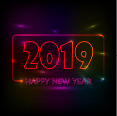 New Year's Eco-congratulation with the new 2019 year and the inscription Happy New Year on a color blurred background
