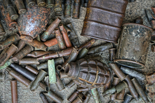 Military background with cartridges of grenades and machine