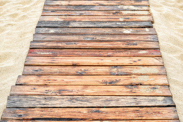 Natural wood planks on the sand for background